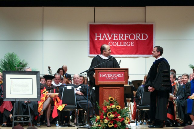 Howard Lutnick, Co-Chair of the Haverford College Board of Managers presents the Sharpless Quote to Weiss.