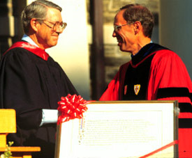 Tom Tritton receives the Sharpless Scroll in 1997 from then-chairman of the Board of Managers, John Hurford '60.