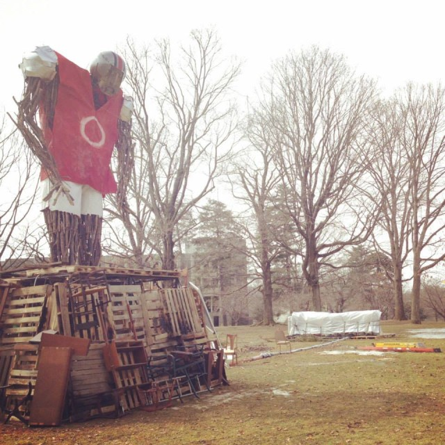 A large wooden football player, constructed for a bonfire at the end of Tuesday's shoot, sits on Merion Green. Photo from Bryn Mawr College Class of 2018 Facebook page.