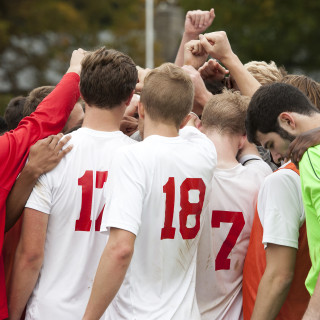 Members of Haverford's mens soccer team bring it in for one last cheer after having upset No. 1 ranked F&M by a score of 3-1 on Saturday morning. October 24, 2015. Ryan Gooding, Staff Photographer