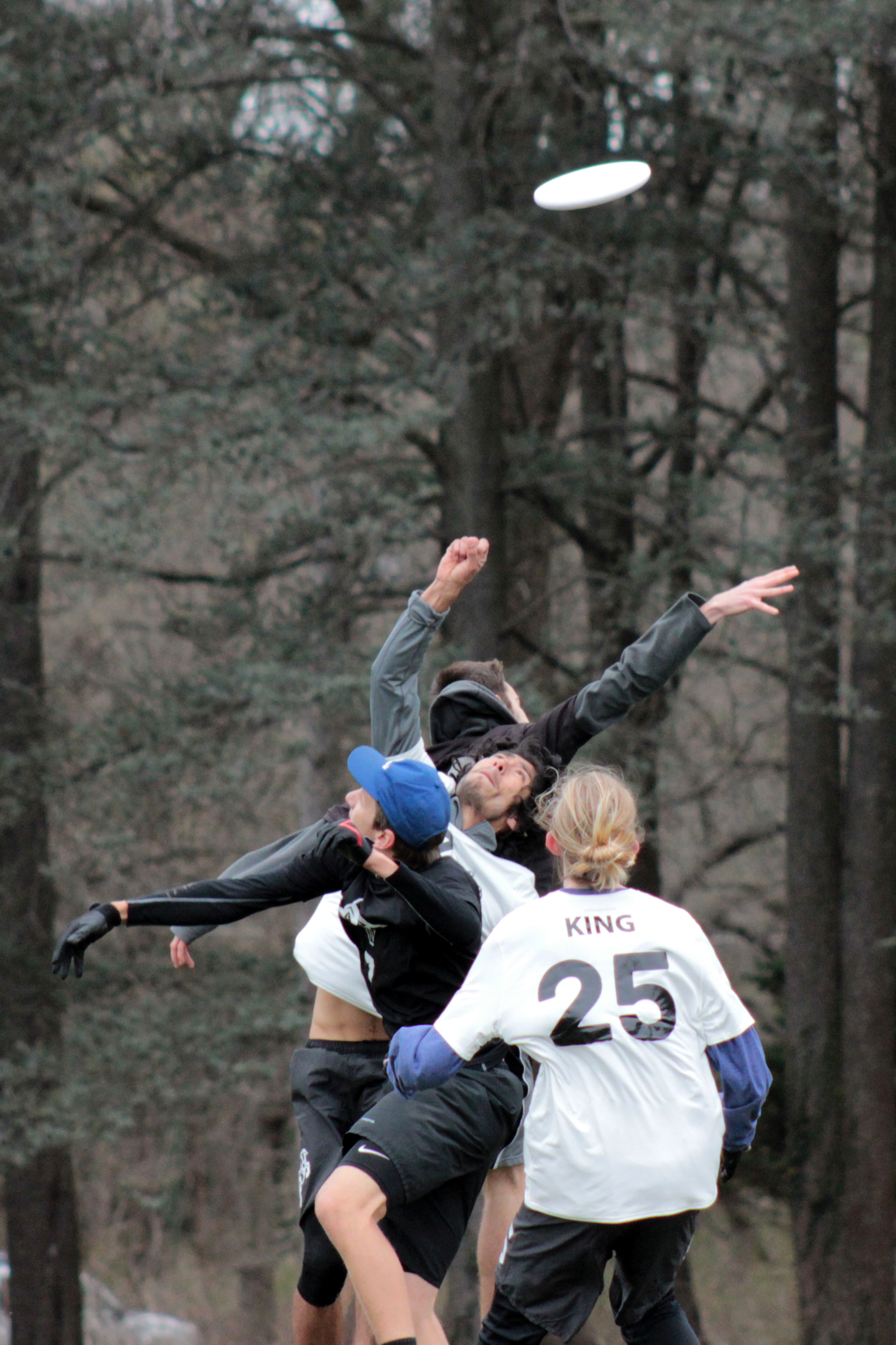 Several players jump for the disc