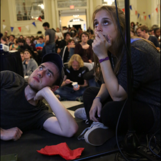 Ben Horwitz '17 and Rachael Garnick '17 of the Haverford College Democrats watch election results come in at the watch party in Founders. Photo by Cole Sansome '18.